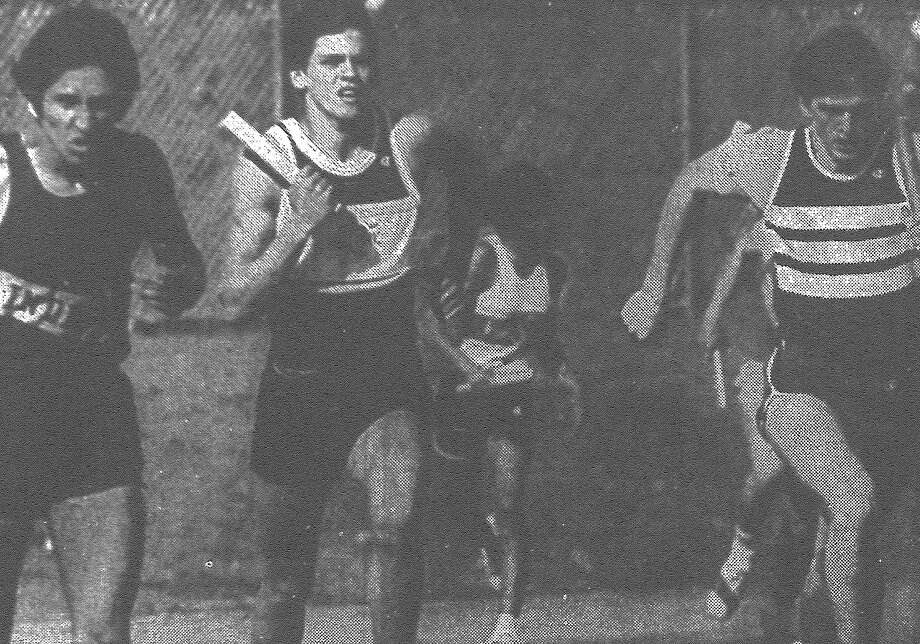 Tony Aldana (from left) of Harlandale, Dennis Nobles of Clark and David Haass of Marshall fight for the lead during the first leg of a mile relay heat in the Harlandale Relays at Northside Stadium. Published in the San Antonio Express March 27, 1983. Photo: File Photo