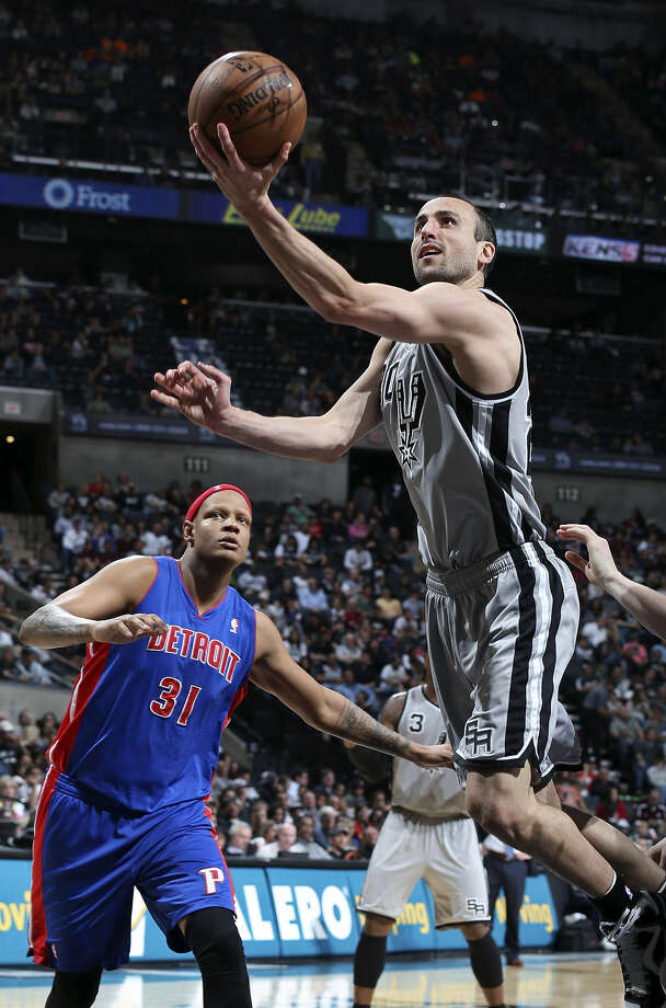 Spurs guard Manu Ginobili, who finished with 17 points, goes past Pistons forward Charlie Villanueva en route to the basket in the first half. The Spurs' one-sided victory avenged a 10-point loss to Detroit in early February. Photo: Edward A. Ornelas / San Antonio Express-News