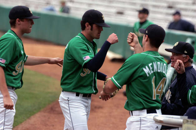 Notre Dame's Jeff Manship greets teammates heading back to the dugout after closing out the top of the second inning against Southern Illinois University at Wolff Stadium in San Antonio Friday March 17, 2006. Manship is a former Reagan High School standout and is considered a pro-league prospect. (MIKE KANE) Photo: MIKE KANE, Express-News / © San Antonio Express-News