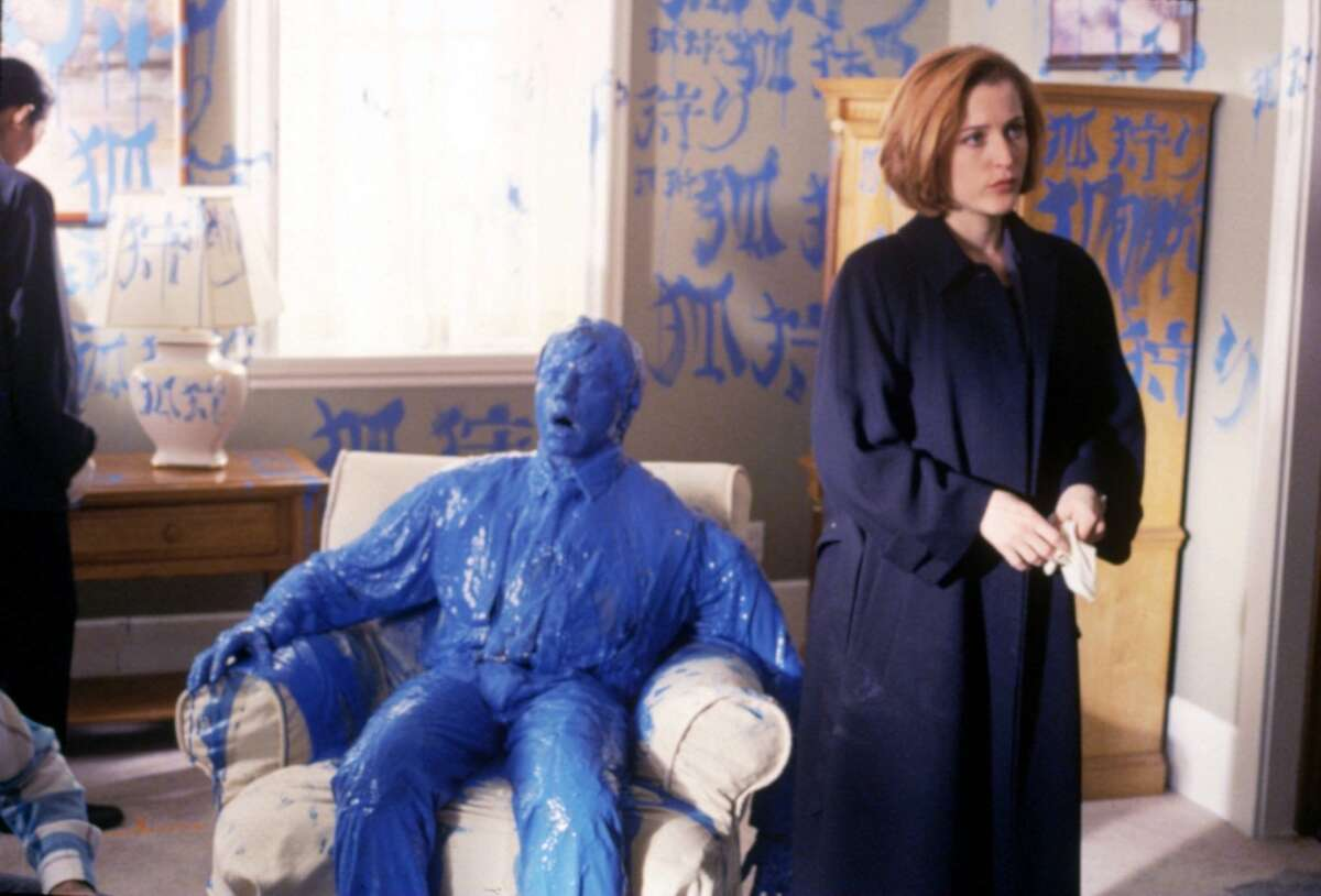 Scully in a 1997 episode involving death by blue paint.