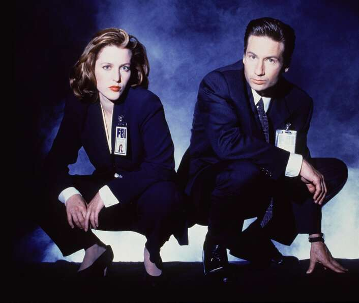 FBI Special Agents Dana Scully, left, and Fox Mulder spent a lot of time squatting and squinting at