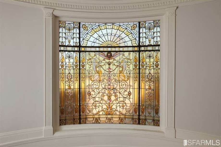 Stained glass window that is seen going upstairs to the higher floors
