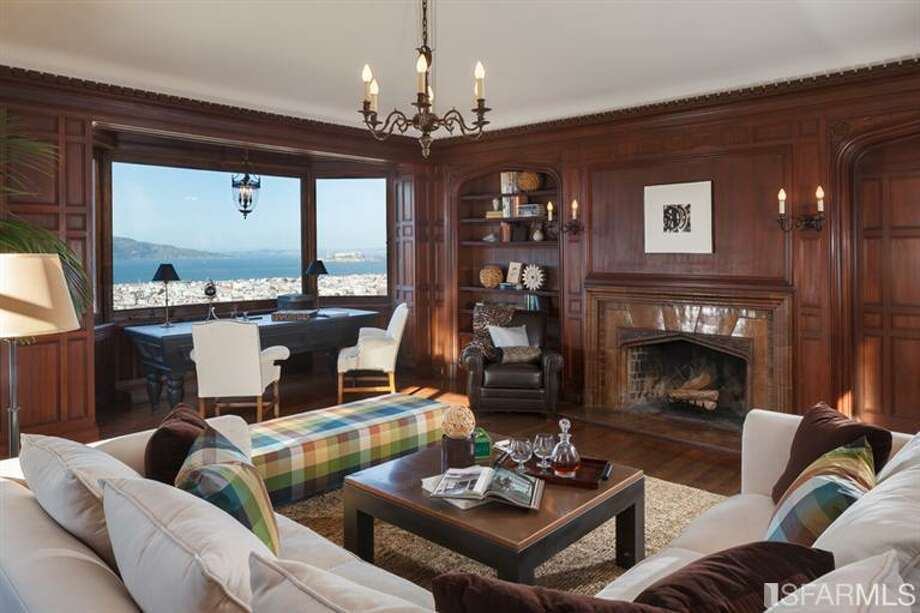 Another living area with wood paneling and views of the bay