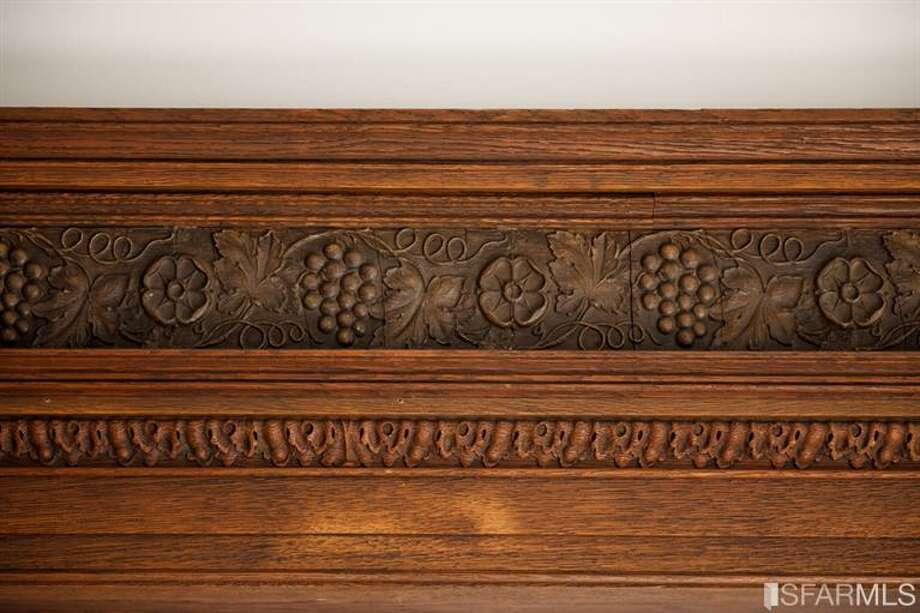 Intricate period detail within the wood paneling