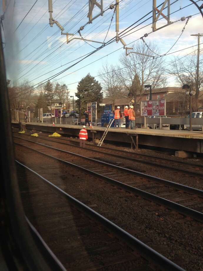 Workers attend the Noroton Heights train station after  man was fatally struck by a train, Monday March 4. Photo: Contributed / Connecticut Post Contributed
