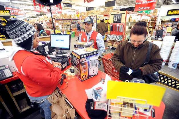 As a potential cold storm approaches Southeast Texas, Joseifina Trejo, right, purchases two electric heaters from M&D Thursday afternoon. John Whitmire and Nichole Lamb assist. Guiseppe Barranco/The Enterprise / Beaumont