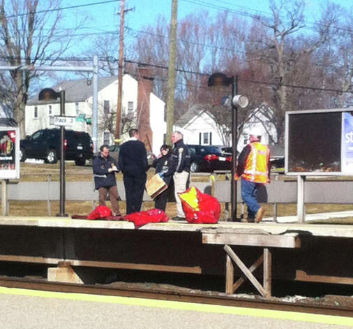 Officials gather on track three at the Noroton Train Station Monday, March 4, after a man was fatally hit by a train at about 6:30 a.m. Photo: Megan Spicer / Darien News / Darien News