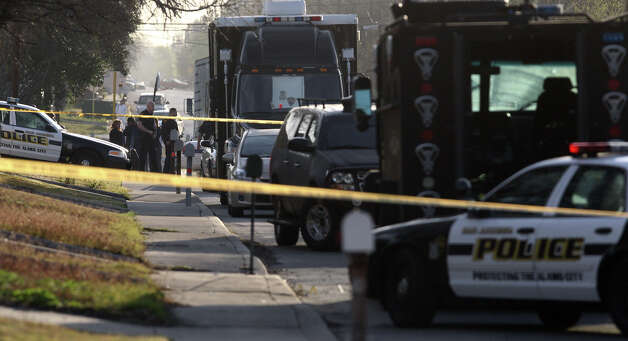 San Antonio police work at the scene of a police involved shooting that took place Monday March 4, 2013 about 6:00 a.m. on the 900 block of Drury. A man allegedly barricaded himself inside a home on the South Side and came out with a rifle and was shot to death by police. Photo: JOHN DAVENPORT, San Antonio Express-News / ©San Antonio Express-News/ Photo may be sold to the public