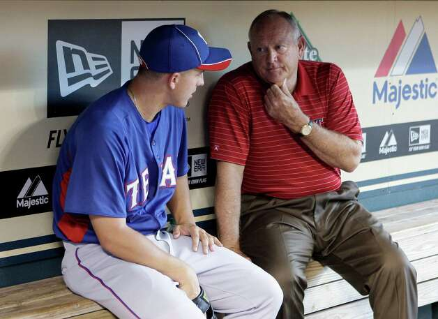 Texas Rangers CEO & PRESIDENT Nolan Ryan right, speaks with Texas Rangers pitcher Derek Holland #45 in the Rangers dugout at Minute Maid Park Wednesday, June 29, 2011, in Houston.  ( James Nielsen / Houston Chronicle ) Photo: James Nielsen, Staff / © 2011 Houston Chronicle