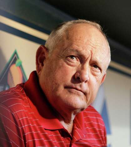 Texas Rangers CEO & PRESIDENT Nolan Ryan speaks with members of the media in the Rangers dugout at Minute Maid Park Wednesday, June 29, 2011, in Houston.   ( James Nielsen / Houston Chronicle ) Photo: James Nielsen, Staff / 2011 Houston Chronicle