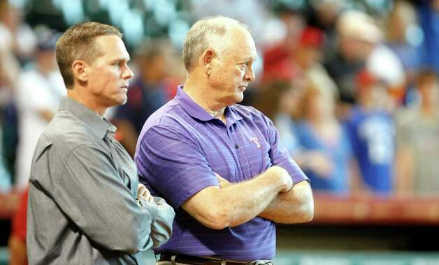 Ex-Houston Astros players Craig Biggio, left, and Nolan Ryan, who's also the principal owner, president and CEO of the Texas Rangers, visit before a Major League Baseball game between the Texas Rangers and Houston Astros, Friday, May 18, 2012, in Minute Maid Park in Houston. ( Nick de la Torre / Houston Chronicle ) Photo: Nick De La Torre, Staff / © 2012  Houston Chronicle