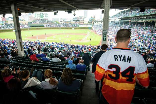 Chris Nielsen wears a number 34 Houston Astros Nolan Ryan jersey as he heads to his seat at Wrigley Field on Wednesday, Oct. 3, 2012, in Chicago.  Nielsen, who is from Michigan, said he wasn't really an Astros fan, he just really liked the vintage rainbow jersey. The season finale marked the Astros final game as a National League team. ( Smiley N. Pool / Houston Chronicle ) Photo: Smiley N. Pool / © 2012  Smiley N. Pool