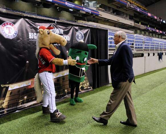 "Nolan Ryan, president and CEO of the Texas Rangers, greets ""Rangers Captain, left, the team's mascot, and the ""Ballapeno,"" mascot of the San Antonio Missions baseball team, during a press conference on Friday, Nov. 16, 2012, to announce ""Big League Weekend,"" a two-game set between the Texas Rangers and the San Diego Padres to be played in the Alamodome on March 29-30, 2013. Photo: Billy Calzada, Staff / © 2012 San Antonio Express-News"