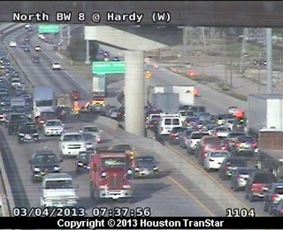 Traffic was snarled after a wreck on the north Sam Houston Parkway near the Hardy Toll Road during rush Monday morning. Photo: Houston Transtar