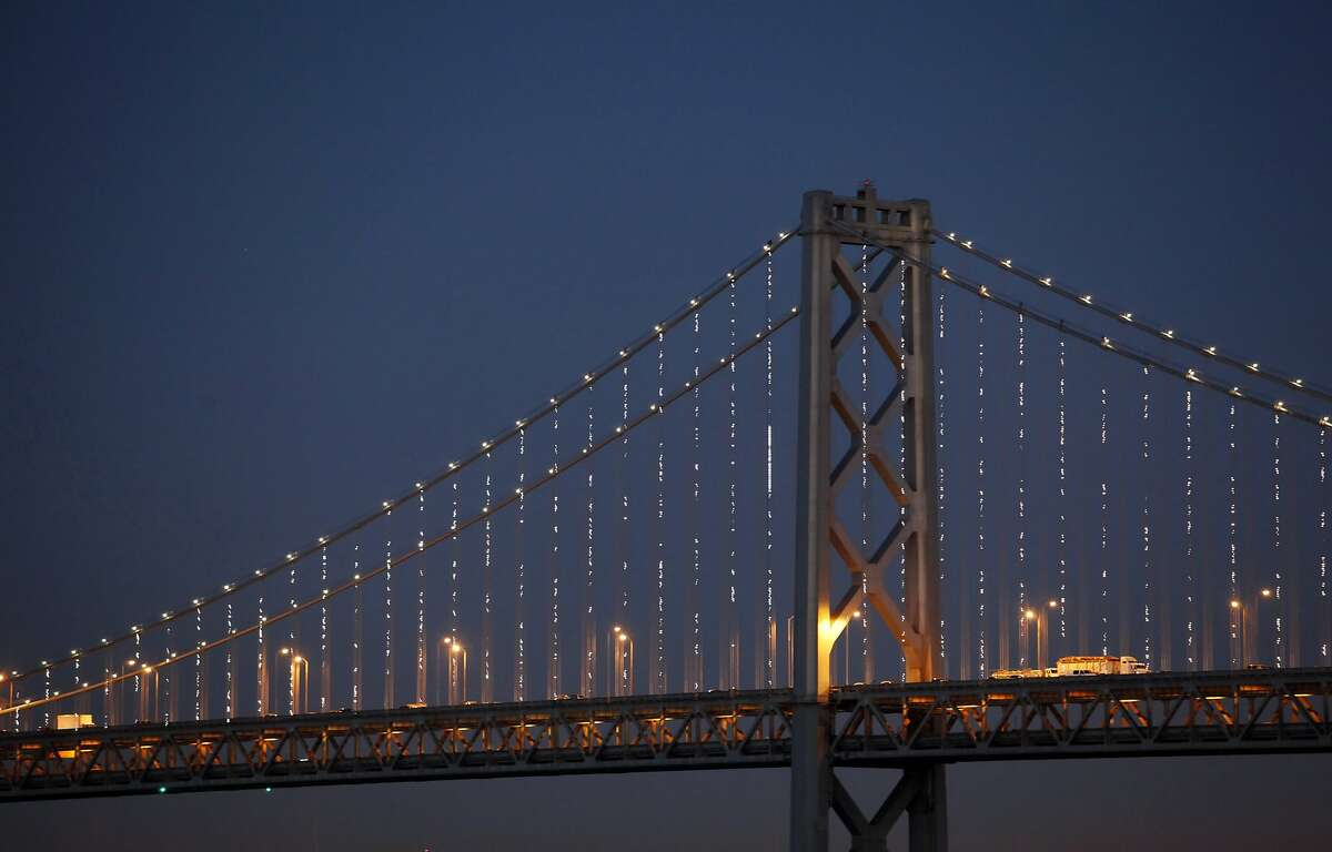 The San Francisco Bay Bridge is alight as artist Leo Villareal tests his Bay Lights installation on Thursday, February 28, 2013, in San Francisco, Calif.