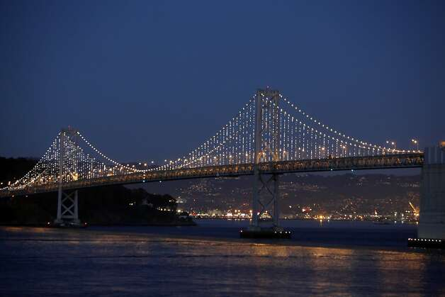 The San Francisco Bay Bridge is alight as artist Leo Villareal tests his Bay Lights installation. Photo: Carlos Avila Gonzalez, The Chronicle