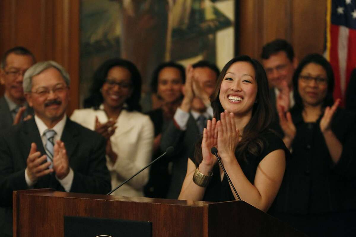 Katy Tang (right), legislative aide to outgoing Supervisor Carmen Chu, speaks during a press conference after Mayor Ed Lee (left) announced Tang as his pick to replace Chu as the District Four representative on the Board of Supervisors on Tuesday, February 26, 2013 in San Francisco, Calif.