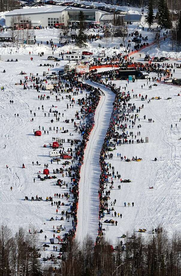 A musher drives their dog team down the start chute across Willow Lake during the Iditarod Trail Sled Dog Race, Sunday, March 3, 2013, in Willow, Alaska. 65 teams will be making their way through punishing wilderness toward the finish line in Nome on Alaska's western coast 1,000 miles away. (AP Photo/The Anchorage Daily News, Bill Roth)  LOCAL TV OUT (KTUU-TV, KTVA-TV) LOCAL PRINT OUT (THE ANCHORAGE PRESS, THE ALASKA DISPATCH) Photo: Bill Roth, Associated Press