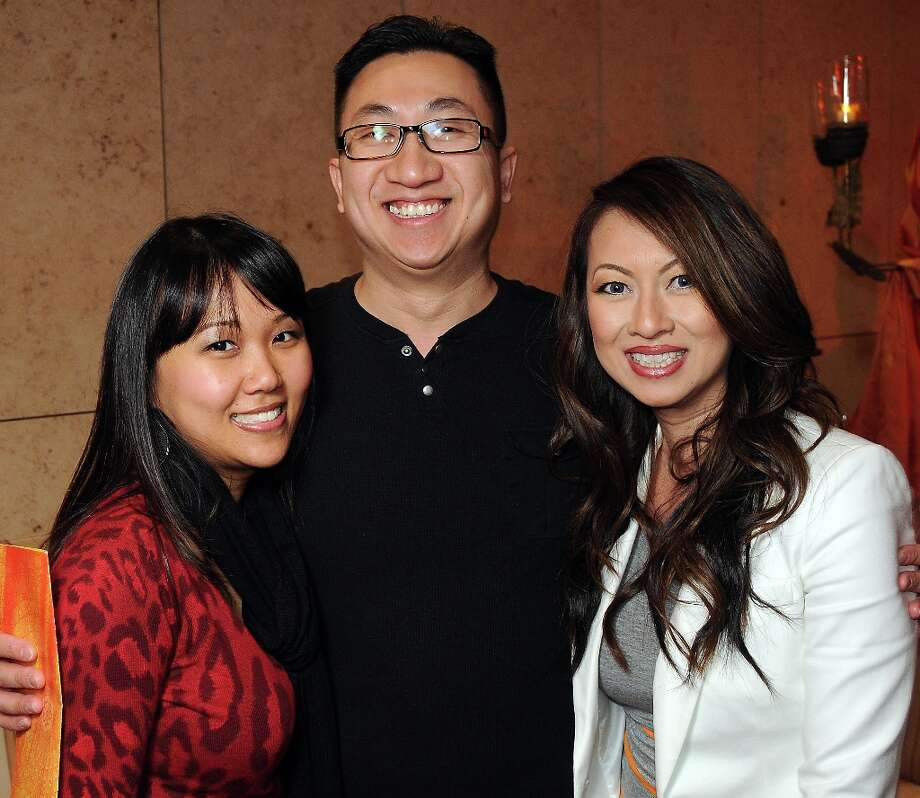 From left: Luu Nguyen and Son Nguyen with Madeline Lee at the Spotlight Asia: Cocktails and Cultural Fusions event at the Asia Society Texas Center Saturday March 02, 2013. Photo: Dave Rossman, For The Houston Chronicle / © 2013 Dave Rossman