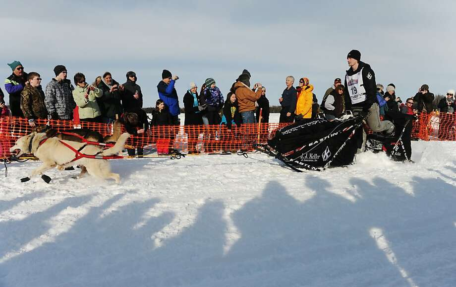 Dallas Seavey leaves the starting line of the Iditarod Trail Sled Dog Race, Sunday, March 3, 2013, in Willow, Alaska. 65 teams will be making their way through punishing wilderness toward the finish line in Nome on Alaska's western coast 1,000 miles away. (AP Photo/The Anchorage Daily News, Bob Hallinen)  LOCAL TV OUT (KTUU-TV, KTVA-TV) LOCAL PRINT OUT (THE ANCHORAGE PRESS, THE ALASKA DISPATCH) Photo: Bob Hallinen, Associated Press