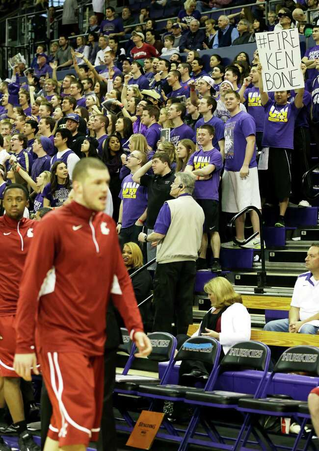 "Washington fans hold signs including one that reads ""Fire Ken Bone"" in reference to the head coach at Washington State, prior to an NCAA college basketball game between Washington and Washington State, Sunday, March 3, 2013, in Seattle. Photo: Ted S. Warren / Associated Press"