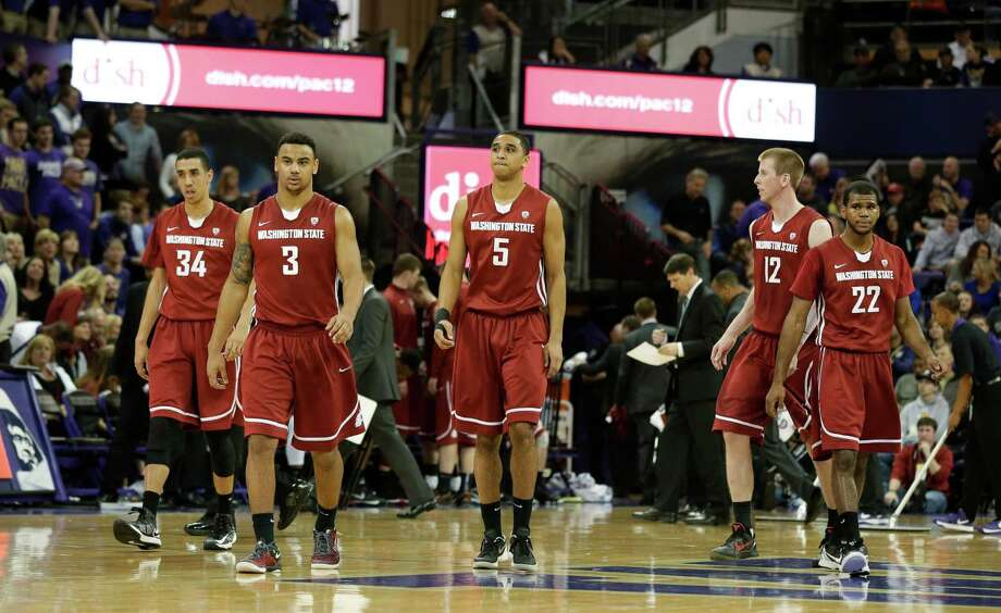 From left to right, Washington State's Dexter Kernich-Drew, DaVonte Lacy, Will DiIorio, Brock Motum and Royce Woolridge walk on the court in the second half of an NCAA college basketball game against Washington, Sunday, March 3, 2013, in Seattle. Washington defeated Washington State 72-78. Photo: Ted S. Warren / Associated Press