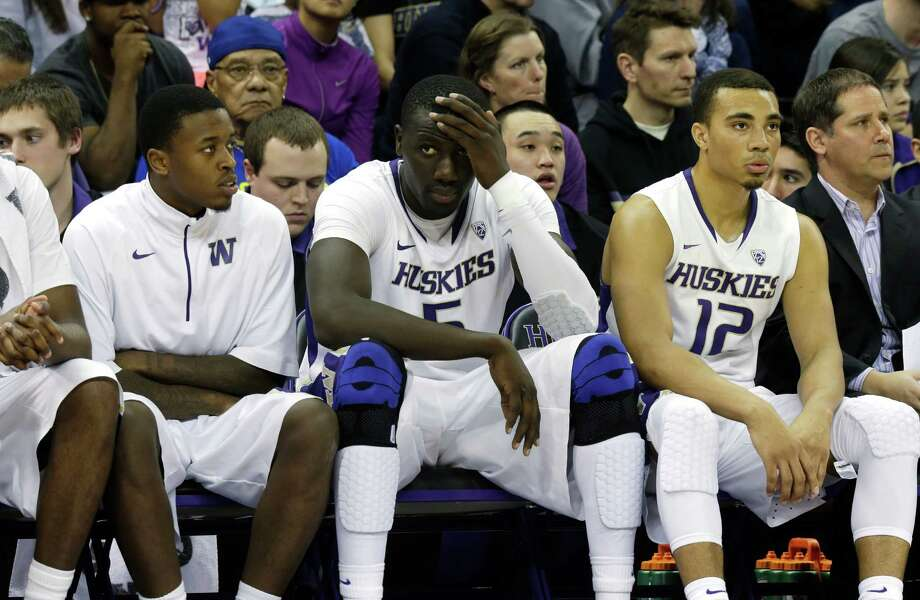 Washington's Aziz N'Diaye, center, and Andrew Andrews, right, rest on the bench during an NCAA college basketball game against Washington State, Sunday, March 3, 2013, in Seattle. Photo: Ted S. Warren / Associated Press