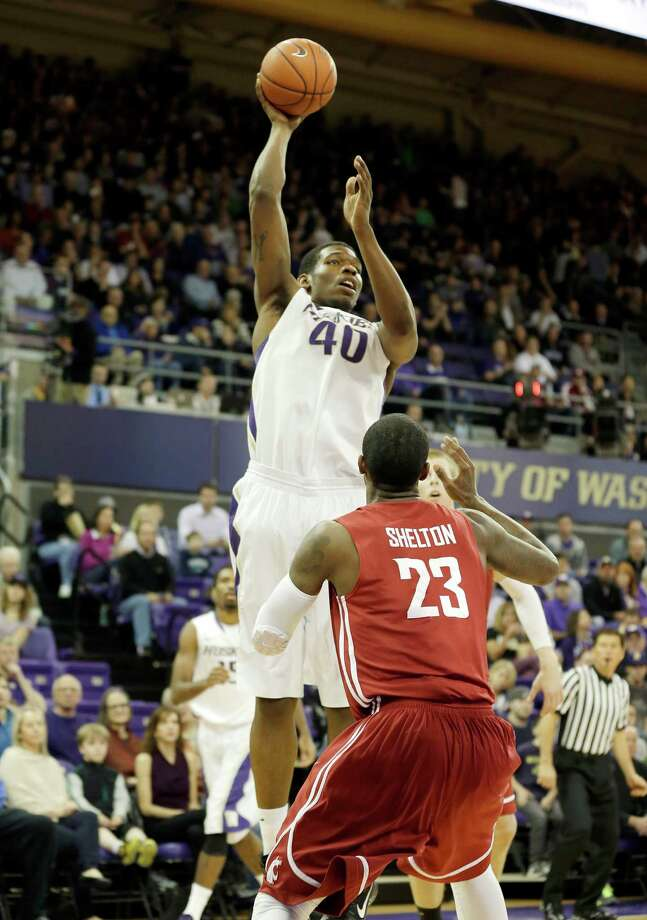 Washington's Shawn Kemp, Jr. (40) shoots over Washington State's D.J. Shelton (23) in the first half of an NCAA college basketball game on Sunday, March 3, 2013, in Seattle. Photo: Ted S. Warren / Associated Press