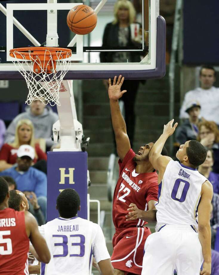Washington State's Royce Woolridge (22) shoots as Washington's Abdul Gaddy (0) defends in the first half of an NCAA college basketball game on Sunday, March 3, 2013, in Seattle. Photo: Ted S. Warren / Associated Press