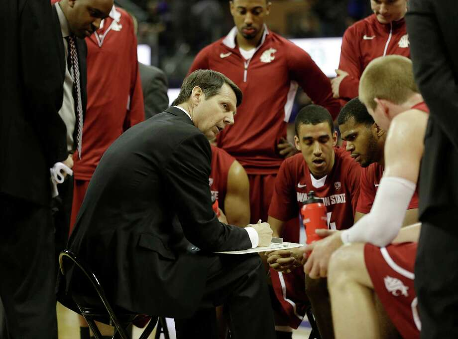 Washington State head basketball coach Ken Bone, center, talks to his players during a time out during an NCAA college basketball game between Washington and Washington State, Sunday, March 3, 2013, in Seattle. Photo: Ted S. Warren / Associated Press