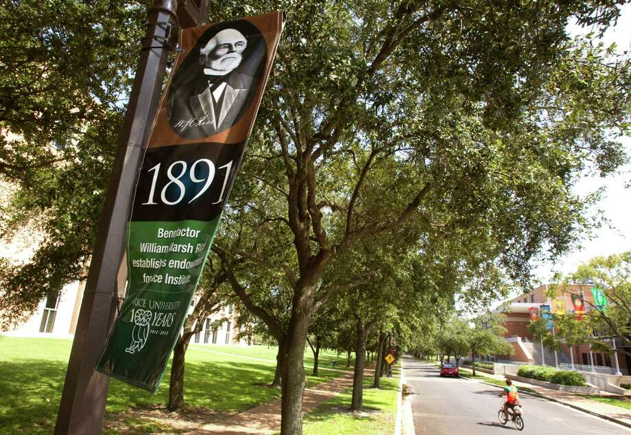 One of the many banners marking milestones in the history of Rice University line the circle around campus Tuesday, Oct. 2, 2012, in Houston. Rice celebrates its 100th anniversary this year. ( Brett Coomer / Houston Chronicle ) Photo: Brett Coomer, HC Staff / © 2012 Houston Chronicle