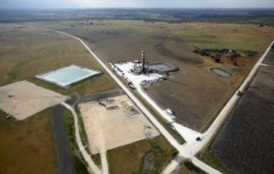 Here's an aerial view of an Eagle Ford Shale drilling rig - and new pad sites clustered nearby - near Kenedy in November 2012. (Photo by William Luther, Express-News)