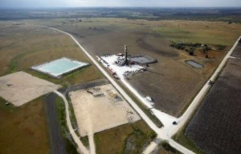 Here's an aerial view of an Eagle Ford Shale drilling rig - and new pad sites clustered nearby - nea