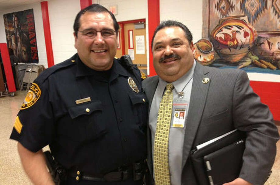Michael Ramirez (left), the new Harlandale ISD chief of police, and superintendent Rey Madrigal pose for a picture. Photo: Courtesy Photo