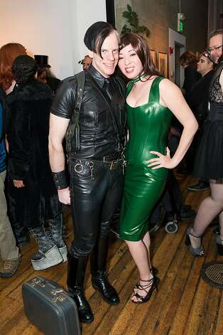 Dan von Hoyel and Kumi Mousten, a retired fetish model, in a green latex dress by Atsuko Kudo, a London designer. Photo: Drew Altizer Photography