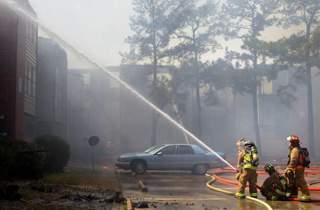 Firefighters battle a 3-alarm blaze at an apartment complex in Northwest Harris County, Monday, March 4, 2013, in Houston. Only one injury took place as 160 firefighters battled the blaze that damaged 60 apartments. Photo: Cody Duty, Houston Chronicle / © 2013  Houston Chronicle