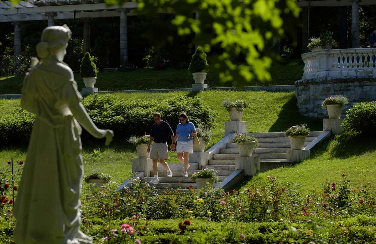 Bill and Allison Clock of Newport News, Va., walk through Yaddo gardens in Saratoga Springs, N.Y., in this July 2005 archive photo. (Paul Buckowski/Times Union archive)