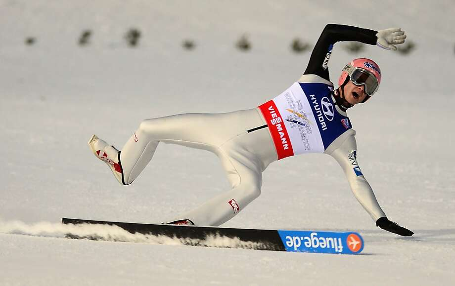 Having lost a ski,Manuel Fettner of Austria tries to land a jump on one leg during the final round of the FIS Nordic World Ski Championships in Val di Fiemme, Italy. Photo: Mike Hewitt, Getty Images