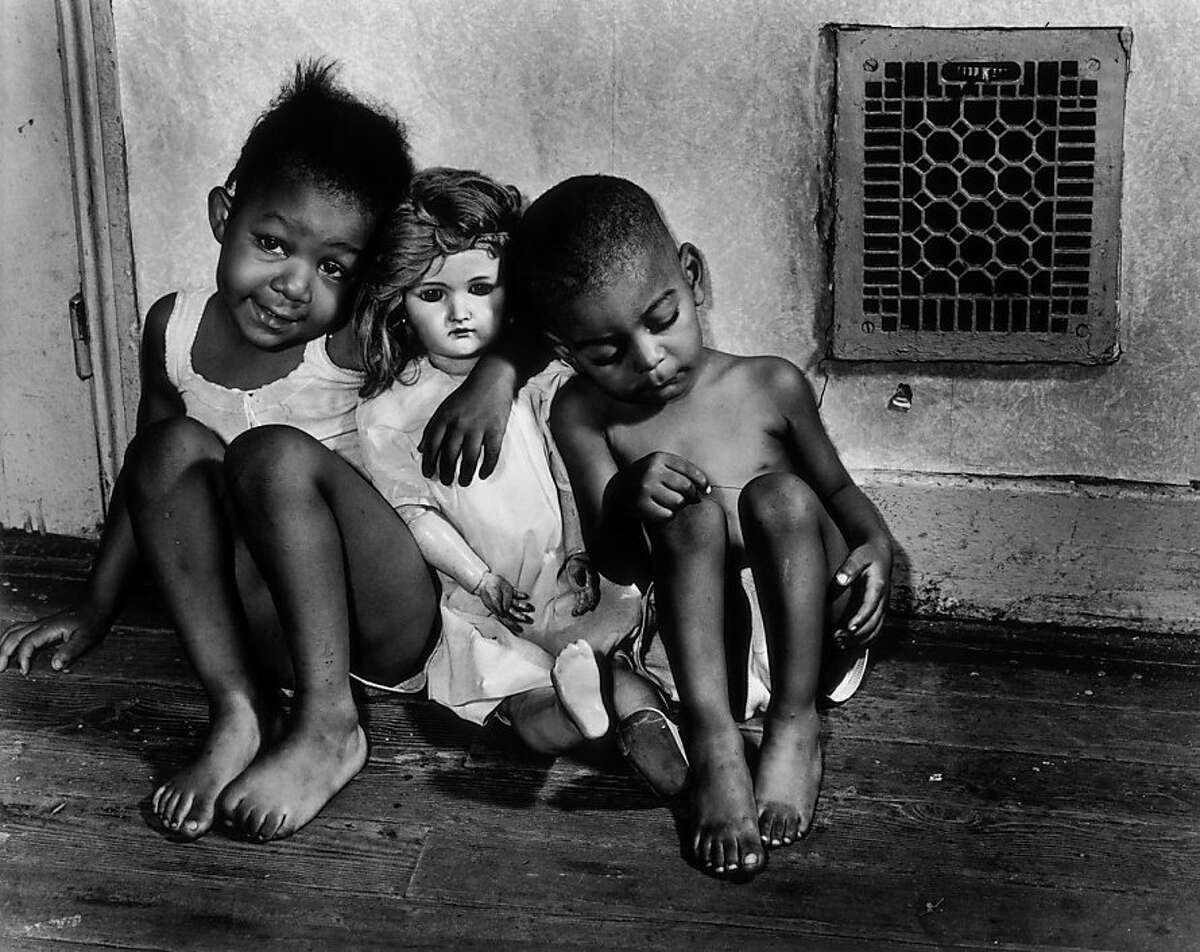 """Gordon Parks' """"Children with Doll, Washington, D.C."""" (1942). Credit for all images must say: Photograph by Gordon Parks, Copyright The Gordon Parks Foundation, Courtesy Jenkins Johnson Gallery."""