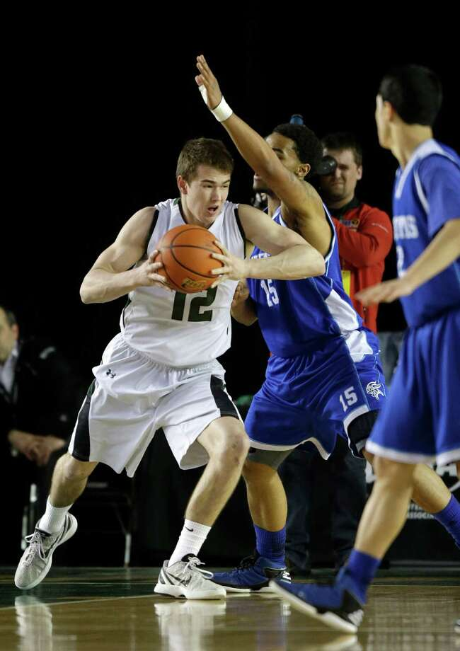 Jackson's Brian Zehr (12) drives around Curtis' Andre Lewis, second from left, in the first half of the division 4A boys high school basketball championship, Saturday, March 2, 2013, in Tacoma, Wash. Photo: Ted S. Warren / Associated Press