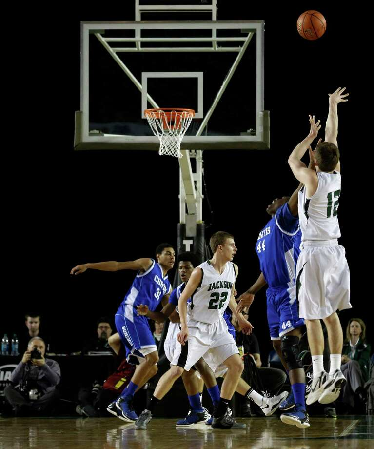 Jackson's Brian Zehr, right, puts up a shot over Curtis' Jaurence Chisolm, second from right, in the first half of the division 4A boys high school basketball championship, Saturday, March 2, 2013, in Tacoma, Wash. Photo: Ted S. Warren / Associated Press