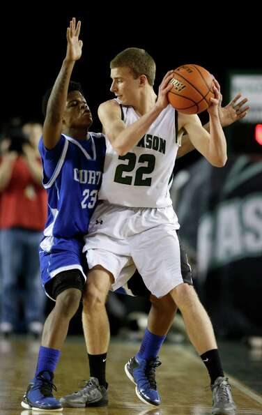 Jackson's Connor Willgress (22) is guarded by Curtis' Jayson Williams (23) in the first half of the