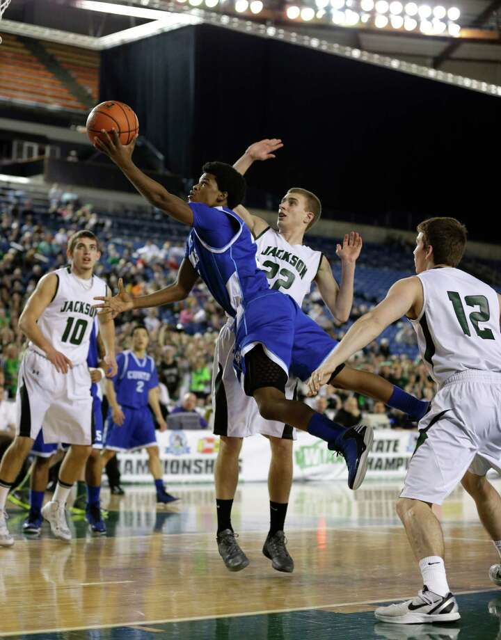 Curtis' Dominic Robinson gets airborne as he puts up a shot against Jackson's Connor Willgress (22) in the first half of the division 4A boys high school basketball championship, Saturday, March 2, 2013, in Tacoma, Wash. Photo: Ted S. Warren / Associated Press