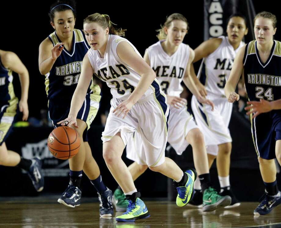 Mead's Mackenzie McPhee, second from left, drives against Arlington in the second half of the division 4A girls high school basketball championship, Saturday, March 2, 2013, in Tacoma, Wash. Mead beat Arlington 58-42. Photo: Ted S. Warren / Associated Press