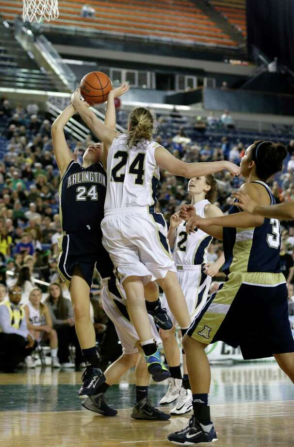 Arlington's Jessica Ludwig, left, shoots against Mead's Mackenzie McPhee, second from left, in the first half of the division 4A girls high school basketball championship, Saturday, March 2, 2013, in Tacoma, Wash. Photo: Ted S. Warren / Associated Press