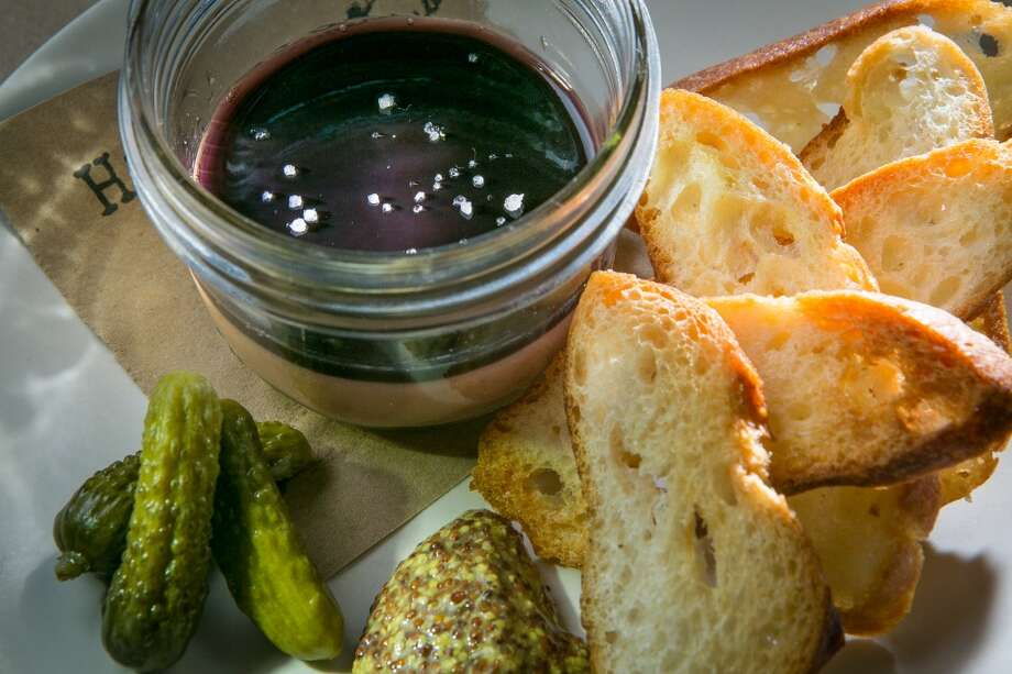 The menu also includes a fine example of a duck liver mousse ($9), served in a glass jar topped with huckleberry gelee. Whole-grain mustard, cornichons and crostini come on the side; unfortunately, the bread wasn't toasted enough so it ended up tasting a little stale.