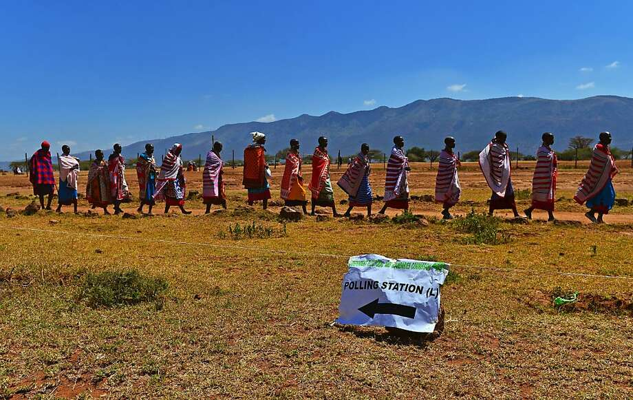 Maasai tribespeople leave their polling station in Kajiado South County, Kenya, during the first presidential election under a new Constitution designed to prevent ethnic violence. Photo: Carl De Souza, AFP/Getty Images