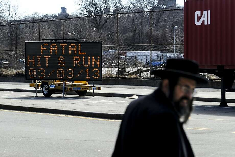 A police sign marks the spot where Nathan and Raizy Glauber died on the way to the hospital. Photo: Robert Stolarik, New York Times