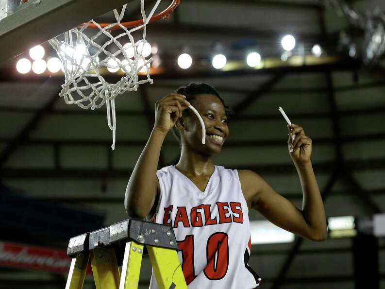 Cleveland's Myzhanique Ladd helps cut down the net after Cleveland defeated Seattle Prep 45-43 in ov