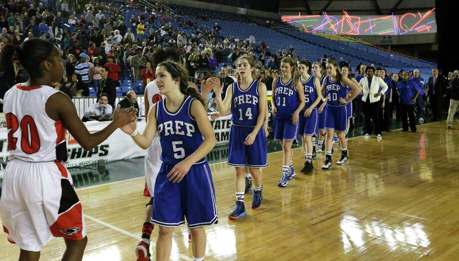 Cleveland's Jayde Christopher, left, is greeted by Seattle Prep's Holly Tonry (5) after Cleveland defeated Seattle Prep 45-43 in overtime of the division 3A girls high school basketball championship on Saturday, March 2, 2013, in Tacoma, Wash. Photo: Ted S. Warren / Associated Press